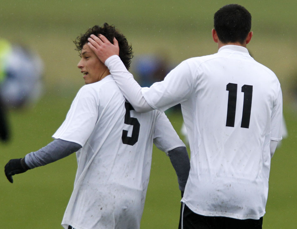 Cheyenne East's Trey Herrera (11) pats teammate Jalen Willet (5) on the back of the head after Willet scored a goal during a Class 4A boy's state soccer fifth place game on Saturday, May 21, 2011, in Sheridan, Wyo.