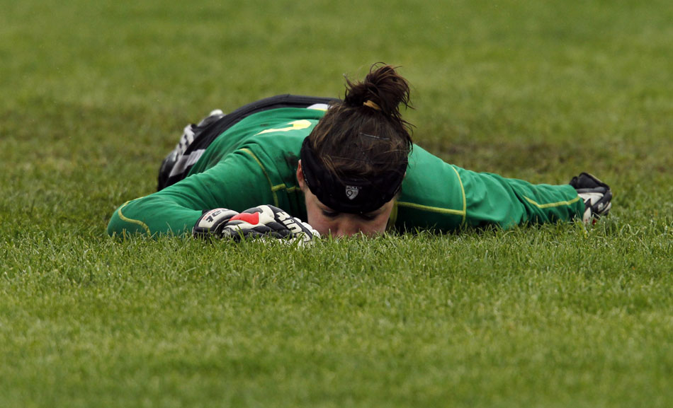 Laramie keeper Rachel Rettinger lies on the soggy pitch after allowing a goal during penalty kicks overtime in the Class 4A girl's state soccer championship game against Gillette on Saturday, May 21, 2011, in Sheridan, Wyo. Laramie lost in a shootout 2-1 (3-1).