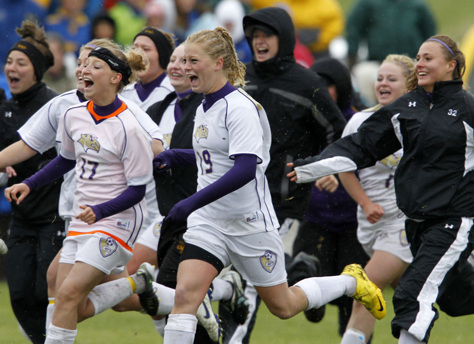 Gillette players storm the pitch after a 2-1 (3-1) shootout win against Laramie in the Class 4A girl's state soccer championship game on Saturday, May 21, 2011, in Sheridan, Wyo.