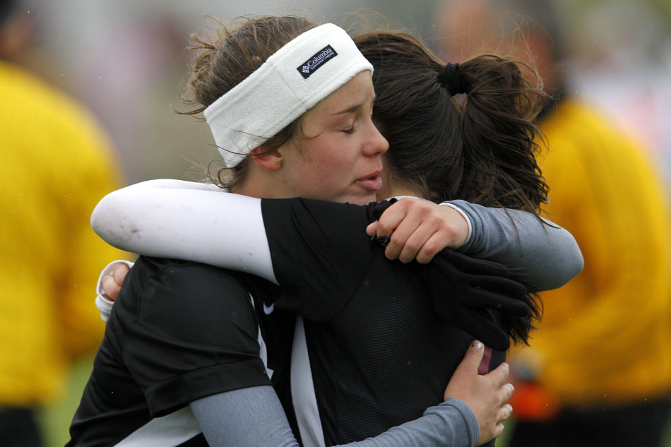 Laramie's Katie Kuhn, left, hugs teammate Haley Moon after a shootout loss to Gillette in the Class 4A girl's state soccer championship game on Saturday, May 21, 2011, in Sheridan, Wyo.