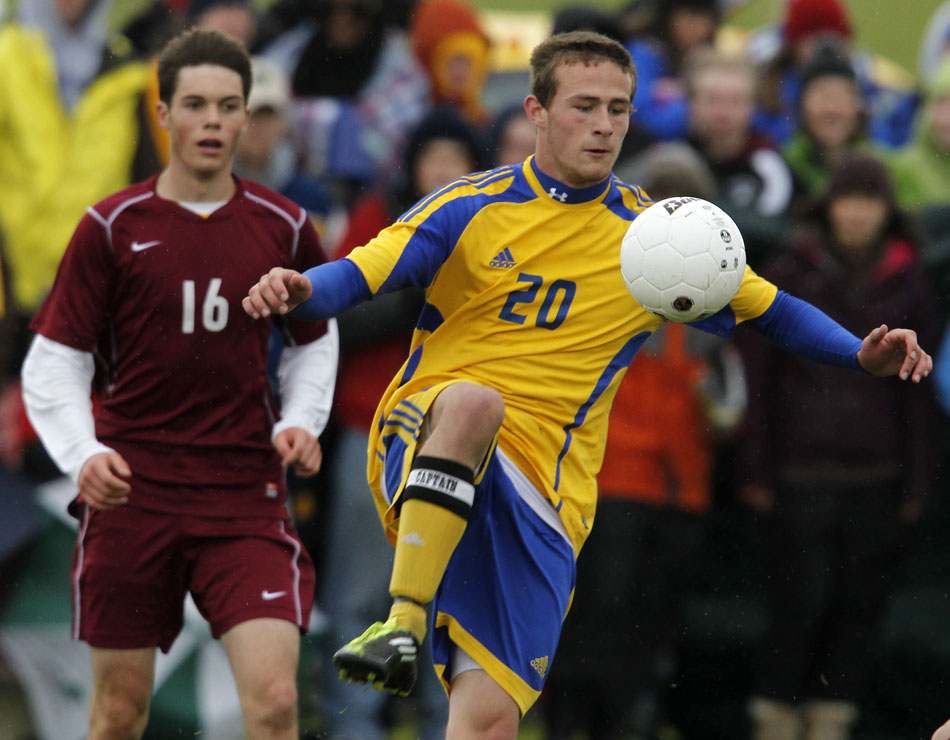 Sheridan's Zack Will (20) plays the ball in front of Laramie's Brock Mosier during the Class 4A boy's state soccer championship game on Saturday, May 21, 2011, in Sheridan, Wyo.