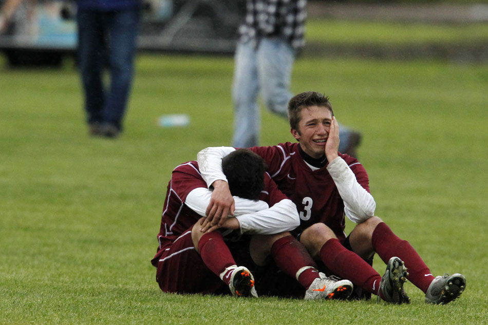 Laramie's Ian Muller (3) shares a moment with a teammate after a 2-1 loss to Sheridan in the Class 4A boy's state soccer championship game on Saturday, May 21, 2011, in Sheridan, Wyo.