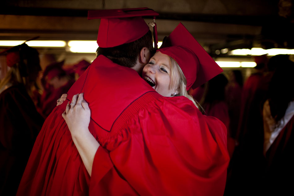 Brittany Singhas hugs a friend as she and her fellow soon-to-be graduates wait for the ceremony to begin on Friday, May 27, 2011, under the grandstands at Frontier Park. Singhas plans to attend the University of Wyoming.