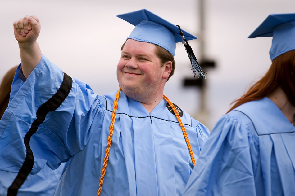 Philip Kramer motions to the crowd as he walks onto the field during Cheyenne's East High School graduation ceremonies on Saturday, May 28, 2011, at Okie Blanchard Stadium. Kramer was one of three seniors to speak to the class during the ceremony.