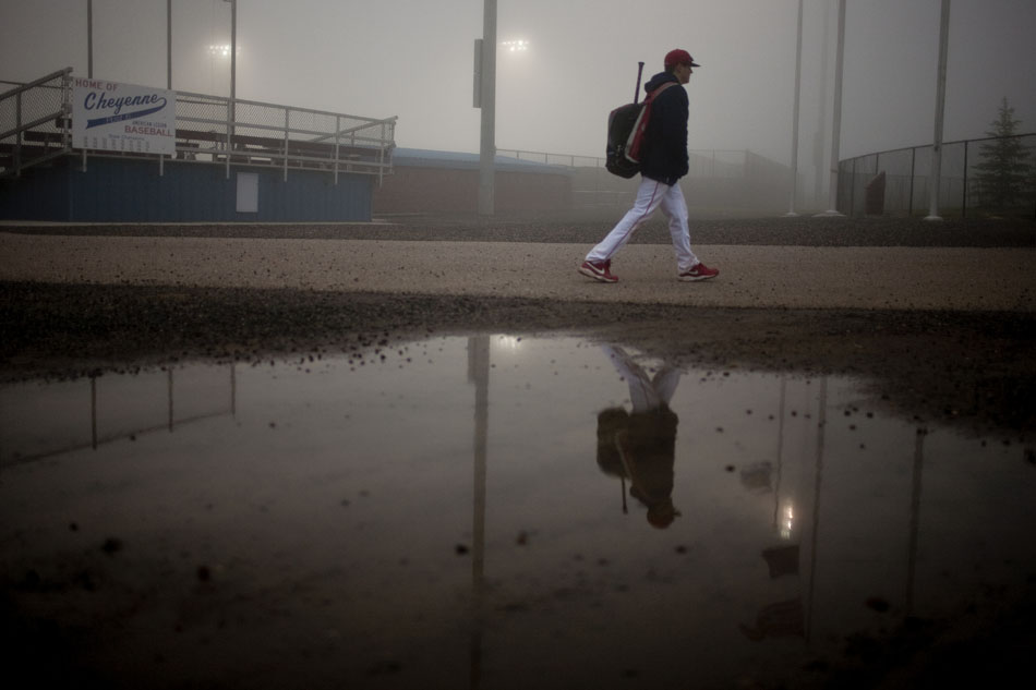 A Cheyenne Post 6 junior varsity player leaves Powers Field after the junior varsity game was called due to dense fog on Sunday, May 29, 2011, in Cheyenne. The fog blanketed the outfield making it hard to see pop ups, forcing officials to postpone a game between Cheyenne Post 6 and Ralston Valley until 9 a.m. on Monday.