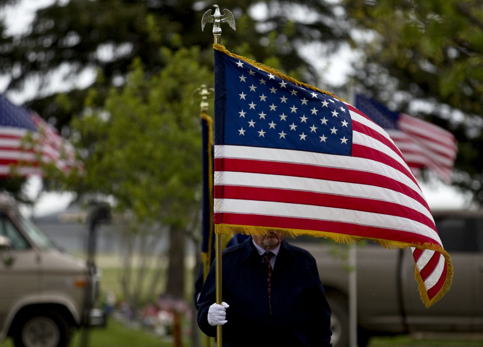 An American flag blows in the wind and rain during a Memorial Day ceremony on Monday, May 30, 2011, at Beth El Cemetery in Cheyenne.