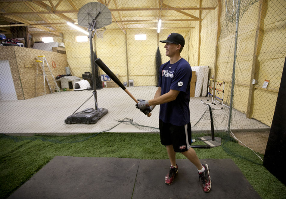 Brandon Nimmo takes a few practice swings inside a batting cage that occupies the family's 2688 sq. ft. barn on Tuesday, June 21, 2011, in Cheyenne, Wyo. The New York Mets recently selected Nimmo at No. 13 overall in the 2011 MLB draft. (James Brosher / Special to New York Post)