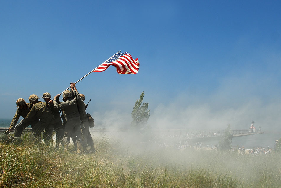 U.S Marine re-enactors portray the famous Iwo Jima flag raising after re-enactments of of D-Day and Pacific Theater landings on Saturday, June 20, 2009 at Tiscornia Beach in St. Joseph, Mich. (James Brosher/South Bend Tribune)