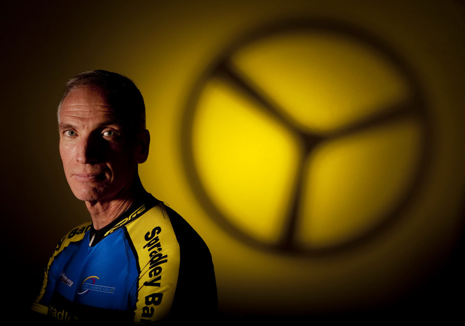 John Cox, the WYDOT director, poses for a portrait on Tuesday, Aug. 9, 2011, with the front wheel of his time trial bicycle shadowed in the background. Cox is competing in the cycling time trial and road race in this year's senior olympics.