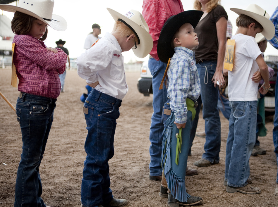 Youngsters wait in line as they make their way into the chutes for the mutton bustin at the Laramie County Fair on Wednesday, Aug. 10, 2011, at Frontier Park.