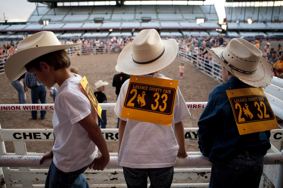 Zach Babb, 7, left, Isaiah Babb, 5, and Logan Mansur-Holaday, 5, wait behind the chutes during the Laramie County Fair's mutton bustin on Wednesday, Aug. 10, 2011, at Frontier Park.