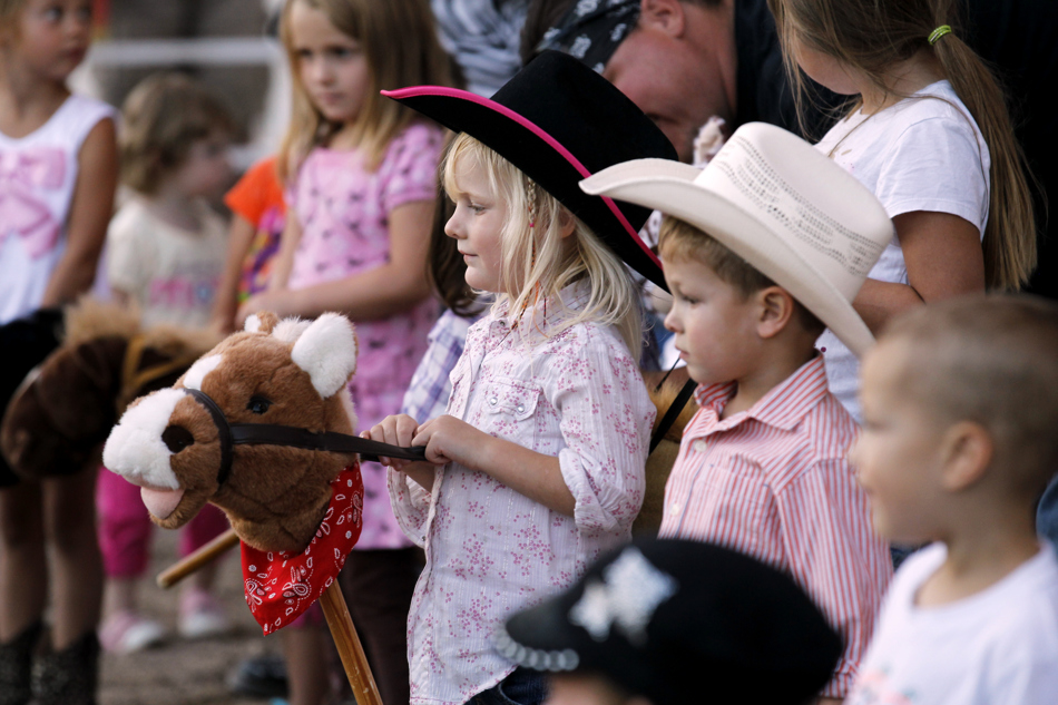 Youngsters line up for the stick pony race during a break in the mutton bustin at the Laramie County Fair on Wednesday, Aug. 10, 2011, at Frontier Park.