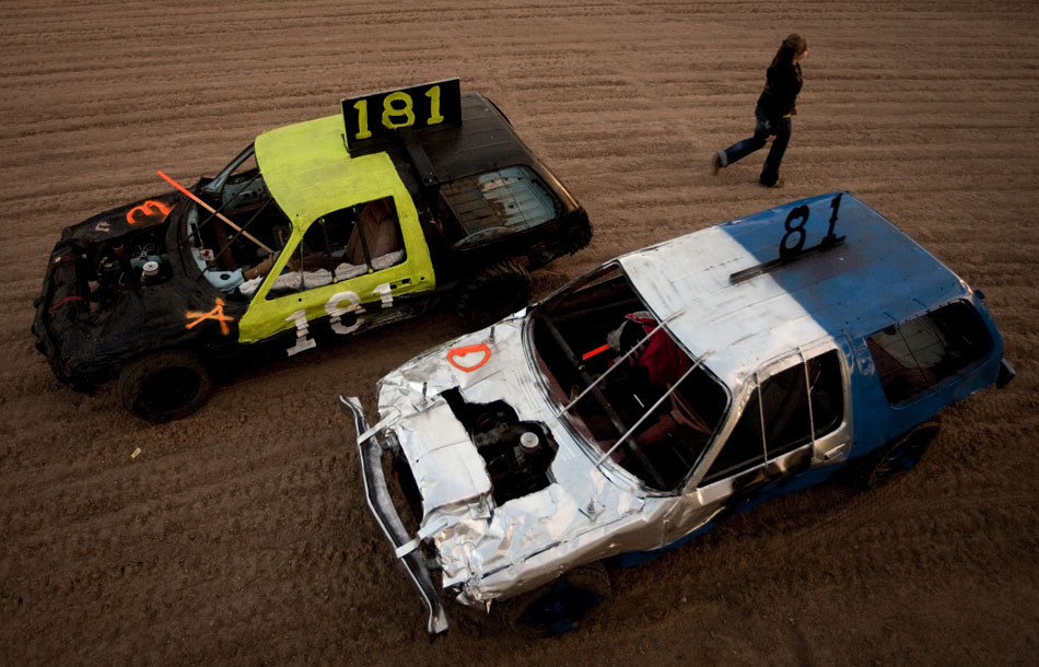 Demolition derby cars sit on the track before the start of the Laramie County Fair's demolition derby on Friday, Aug. 12, 2011, at Frontier Park.