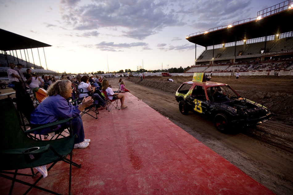 A demolition derby competitor drives past the photo pit during the Laramie County Fair's demolition derby on Friday, Aug. 12, 2011, at Frontier Park.