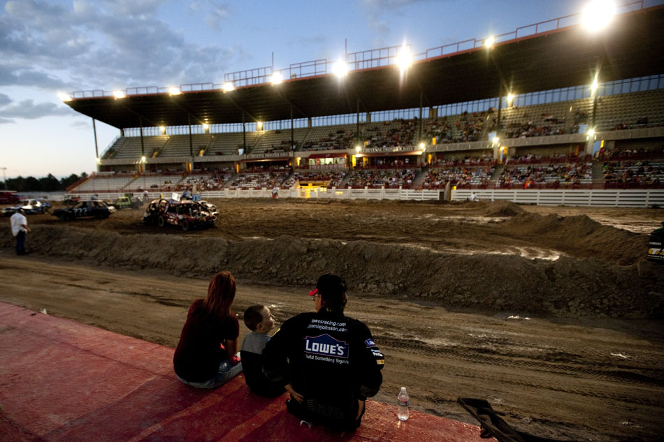 A family watches the action from atop the photo pit during the Laramie County Fair's demolition derby on Friday, Aug. 12, 2011, at Frontier Park.