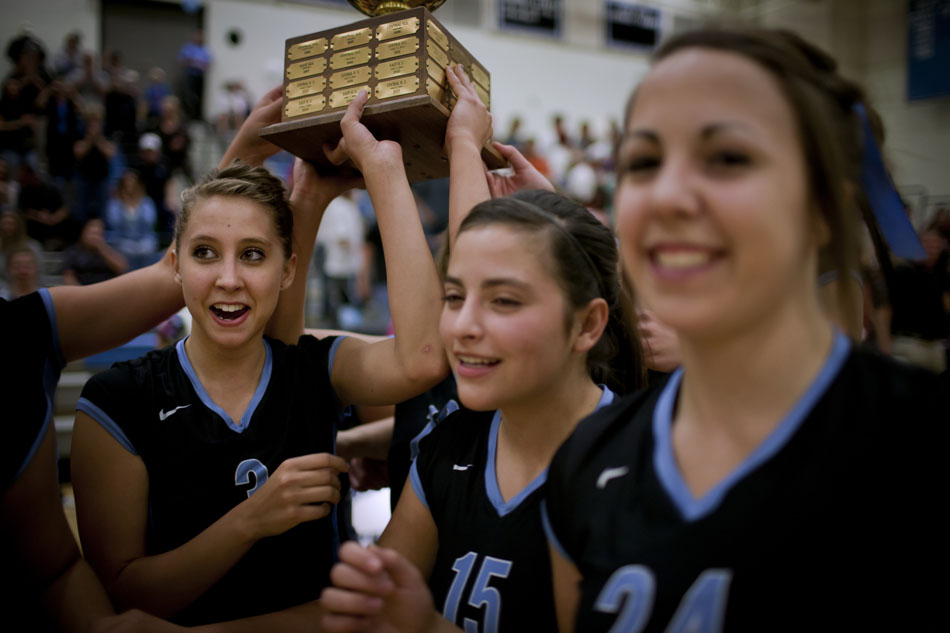 Cheyenne East's Cheyenne Maclin, left, celebrates a win against Central after a volleyball game on Thursday, Oct. 6, 2011, at Cheyenne East High School.