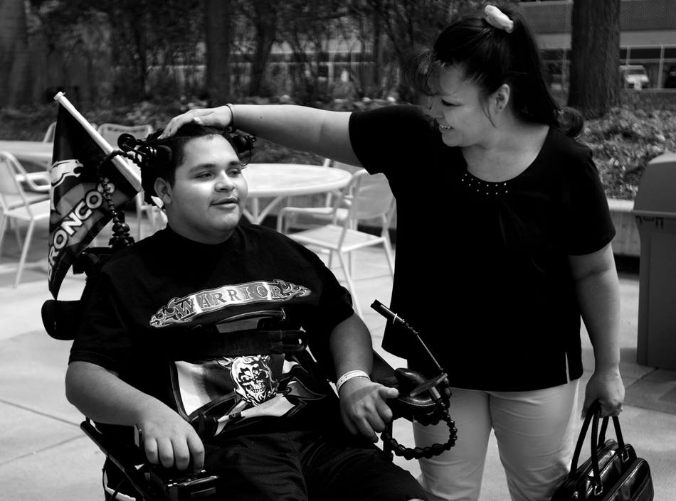Melissa Plumley shares a laugh with her son, Isaac Salas on Friday, May 6, 2011, at Craig Hospital in Englewood, Colo. After his injury and eventual move to Craig Hospital, Melissa rented an apartment on the east side of the hospital, spending time with Isaac as he went about his recovery and physical therapy. She typically making trips back to Cheyenne once a week on Fridays. (James Brosher/Wyoming Tribune Eagle)