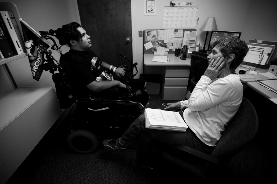 Mary Ratigan, a tutor at Craig Hospital, reacts as he talks about mathematical graphs with Isaac Salas on Friday, May 6, 2011, at the hospital in Englewood, Colo. Isaac acted like he was tired to get out of the tutoring session early. (James Brosher/Wyoming Tribune Eagle)