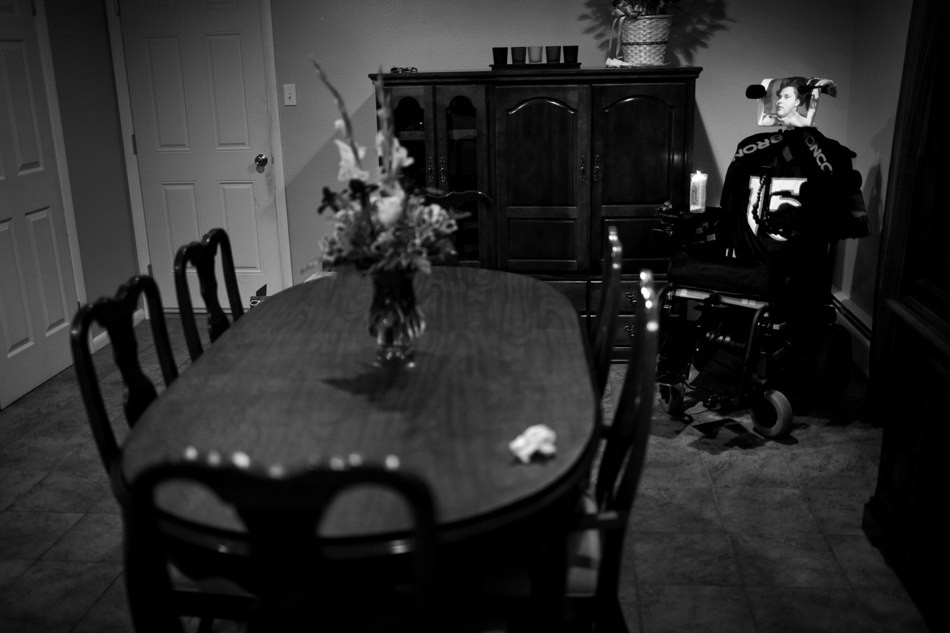 "Isaac Salas' motorized wheelchair sits in the corner of his family's dining room as the family prepares a Thanksgiving meal in the nearby kitchen on Thursday, Nov. 24, 2011, in Cheyenne. The chair highlights Isaac's tale: His family wants to remember, but also needs to move on. ""I try to keep myself busy so I don't think about it. The night is always the toughest,"" Melissa Plumley, Isaac's mother said. ""I don't know if that's right or healthy, but it feels right to me."" (James Brosher/Wyoming Tribune Eagle)"