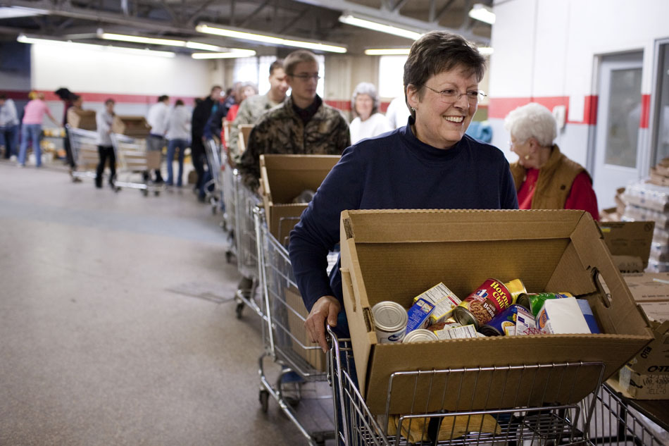 Debby Phillips pushes a cart as she and several other volunteers help assemble Christmas baskets on Tuesday, Dec. 20, 2011, in downtown Cheyenne. Volunteers were assembling baskets for the Laramie County Christmas Program. (James Brosher/Wyoming Tribune Eagle)