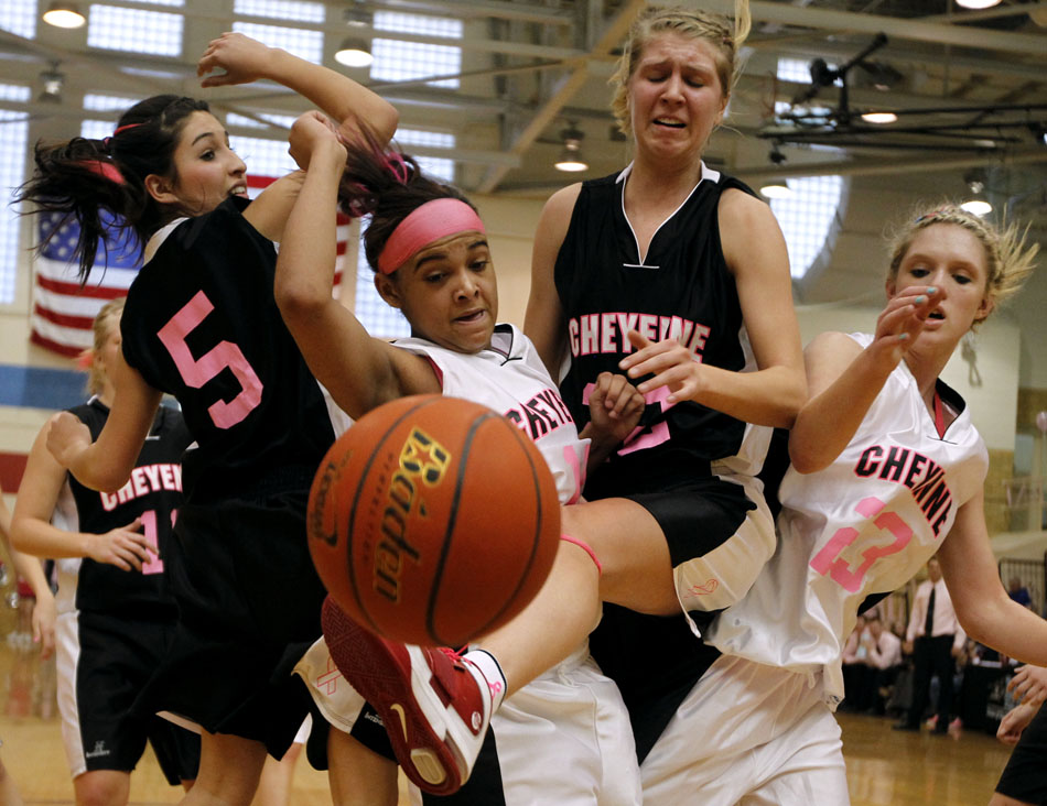 2011 year in pictures james brosher photography cheyenne easts lexi hawkins second from right looses the handle on a rebound in publicscrutiny Gallery