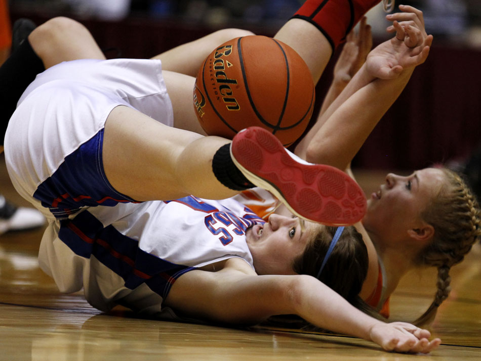 Lovell's Karen Koritnik watches as the ball bounces away from her as she falls to the floor with Burns' Becca Miller during the Class 2A championship game on Saturday, March 5, 2011, in Casper, Wyo. (James Brosher/Wyoming Tribune Eagle)