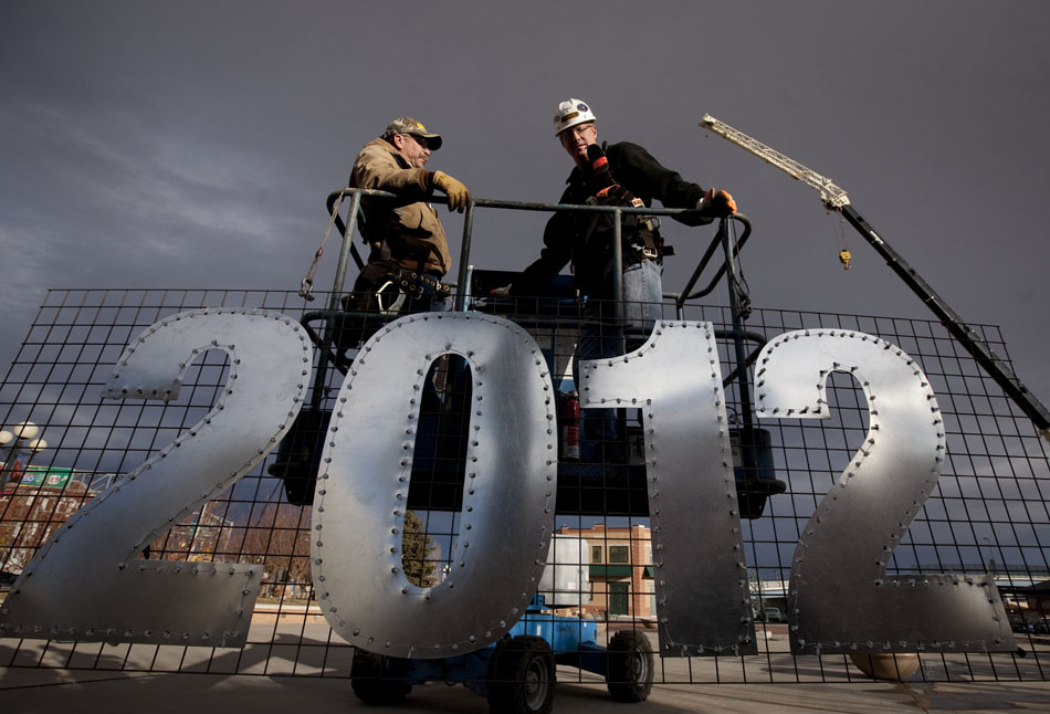 Blake Wilson, right, president of C.H. Yarber Construction, and Paul Bartow prepare to hang a lighted 2012 sign on Friday, Dec. 30, 2011, from the arch entry to the Cheyenne Depot Plaza in preparation for a ball drop on New Year's Eve. The ball will drop from approximately seven stories high during the count down to midnight on Saturday. (James Brosher/Wyoming Tribune Eagle)