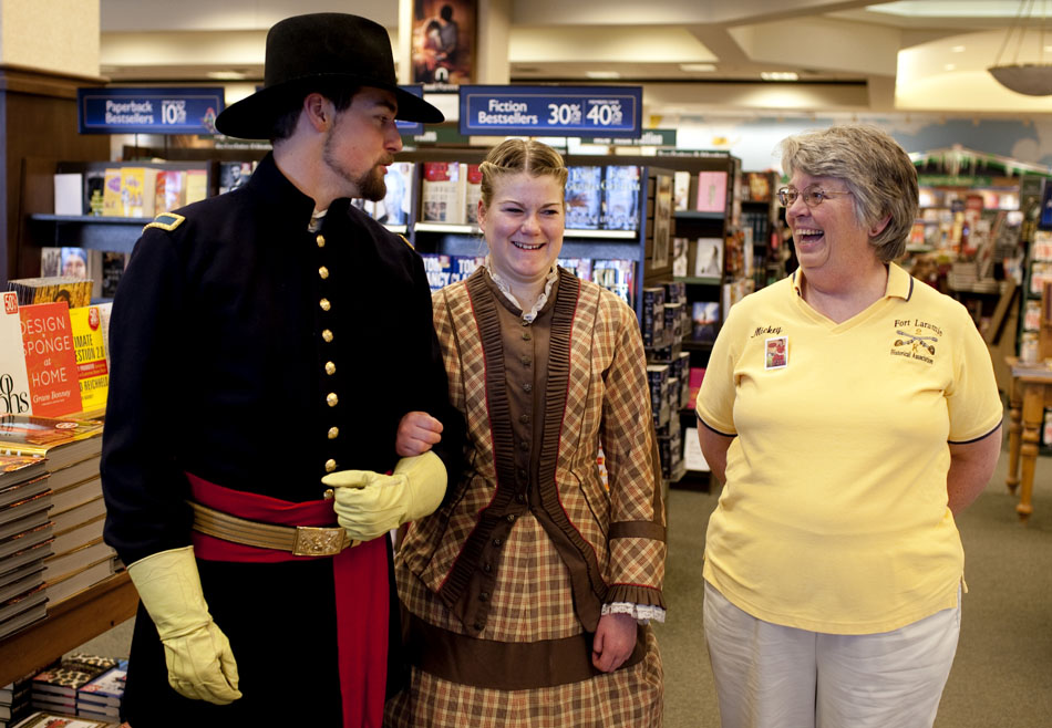"""Mickey Lewis, right, a member of the Fort Laramie Historical Association, shars a laugh with Hannah Buettner and Brandon Lewis on Saturday, Jan. 7, 2012, at the Barnes and Noble in Cheyenne. The two were depicting main characters, Lt. Ethan Bowles and Abigail Harding, from Amanda Cabot's new book, """"Summer of Promise,"""" during a book signing at the store. The book is set in Fort Laramie, Wyo. in 1885. (James Brosher/Wyoming Tribune Eagle)"""