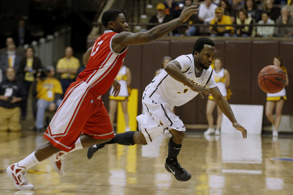 Wyoming guard JayDee Luster goes after a loose ball in front of New Mexico guard Jamal Fenton during a NCAA men's basketball game on Saturday, Jan. 14, 2012, at the Arena-Auditorium in Laramie, Wyo. Wyoming lost 72-62. (James Brosher/Wyoming Tribune Eagle)