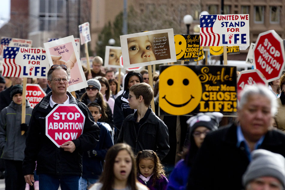 More than 600 people march during an anti-abortion rally on Saturday, Jan. 21, 2012, along Capitol Avenue near the Wyoming State Capitol in Cheyenne. The march, organized by Right to Life of Laramie County, coincides with the 39th anniversary of Roe vs. Wade. (James Brosher/Wyoming Tribune Eagle)