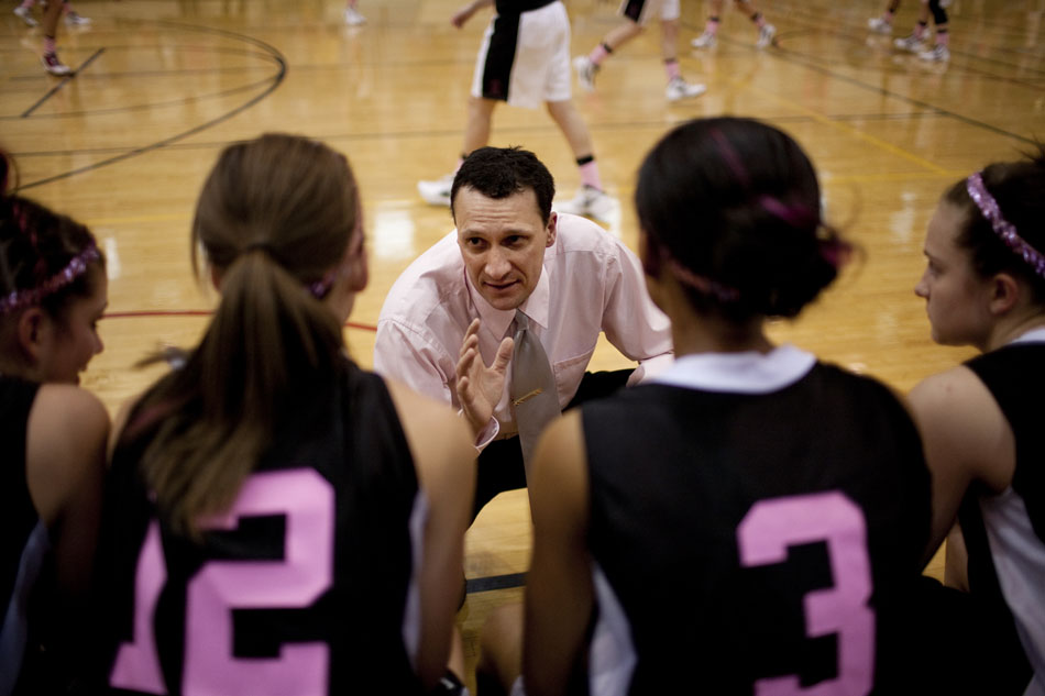 Cheyenne East girl's basketball coach Rusty Horsley talks to his starters on the bench before a high school basketball game against Cheyenne Central on Saturday, Jan. 21, 2012, at Storey Gym in Cheyenne. (James Brosher/Wyoming Tribune Eagle)