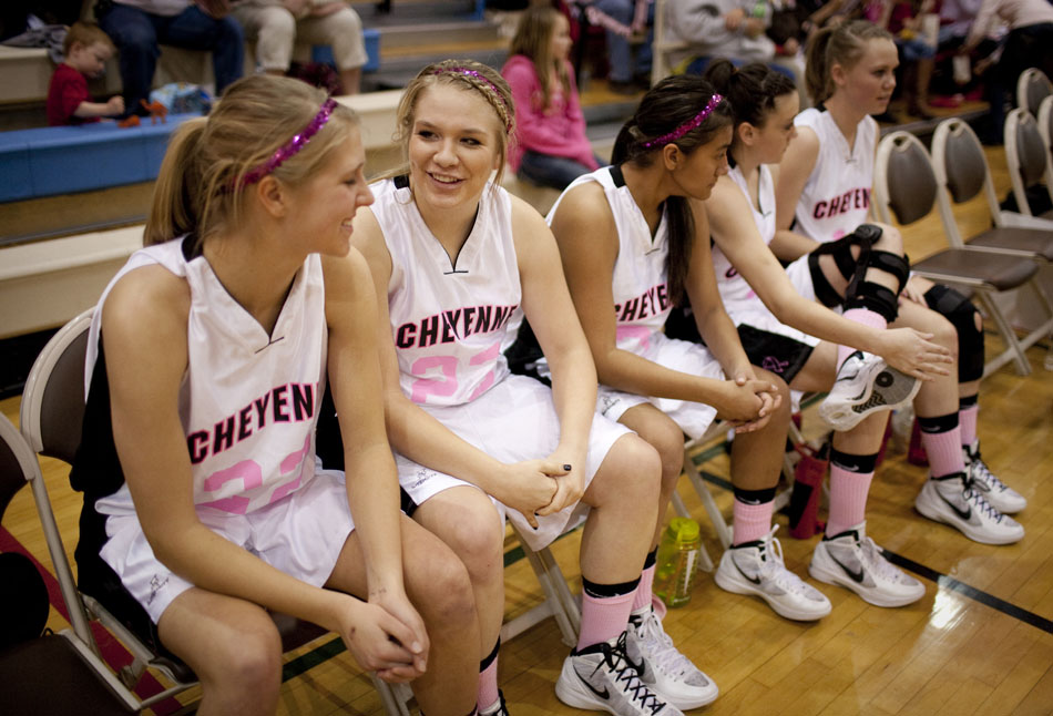 Cheyenne Central's Sierra Kuno, second from left, shares a laugh with teammate Christie Schiel as the two starters wait to be introduced before a high school basketball game against Cheyenne East on Saturday, Jan. 21, 2012, at Storey Gym in Cheyenne. (James Brosher/Wyoming Tribune Eagle)
