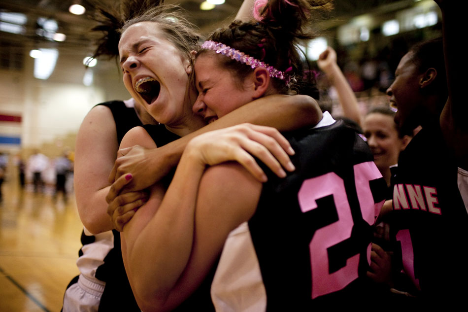 Cheyenne East's Rachel Erickson celebrates with a swarm of teammates after hitting a game-winning shot at the buzzer against Cheyenne Central on Saturday, Jan. 21, 2012, at Storey Gym in Cheyenne. After Central tied the game with seconds remaining, Erickson drove the length of the floor and put up a contested shot at the buzzer to give East a 48-46 win. (James Brosher/Wyoming Tribune Eagle)