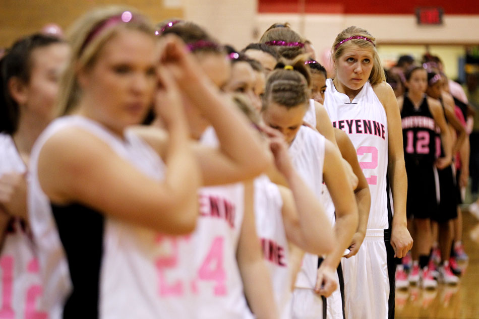 Cheyenne Central's Christie Schiel waits for the playing of the national anthem before a high school basketball game against Cheyenne East on Saturday, Jan. 21, 2012, at Storey Gym in Cheyenne. (James Brosher/Wyoming Tribune Eagle)