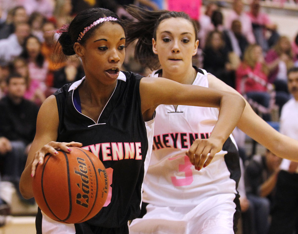 Cheyenne East's Destiny Rudolph works the baseline past Cheyenne Central's Ali McIntyre during a high school basketball game on Saturday, Jan. 21, 2012, at Storey Gym in Cheyenne. (James Brosher/Wyoming Tribune Eagle)