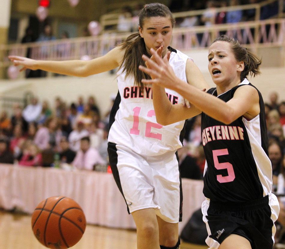 Cheyenne East's Rachel Erickson (5) loses the handle on the ball in front of Cheyenne Central's Kayleen Selfridge during a high school basketball game on Saturday, Jan. 21, 2012, at Storey Gym in Cheyenne. (James Brosher/Wyoming Tribune Eagle)