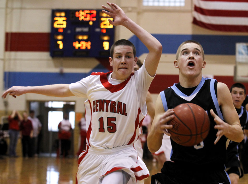 Cheyenne East's Cameron Johnson, right, goes up for a shot in front of Cheyenne Central's Colton Wardell during a high school basketball game on Saturday, Jan. 21, 2012, at Storey Gym in Cheyenne. (James Brosher/Wyoming Tribune Eagle)