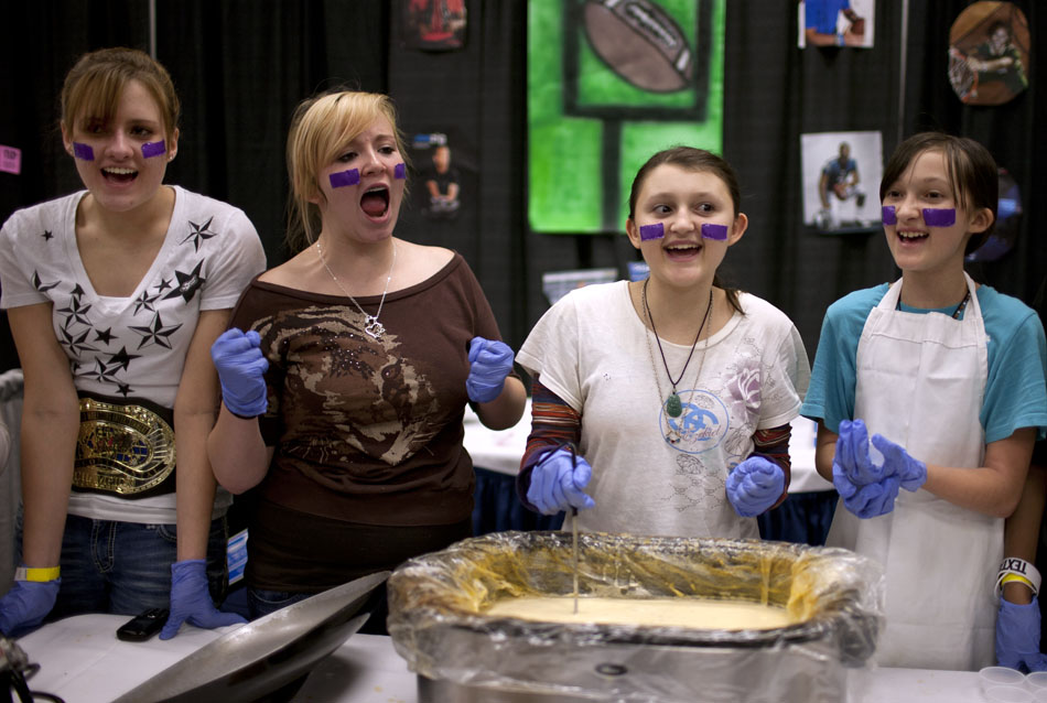Abi Colbert, left, Destiny Wilkinson, Caitlin Hollingsworth and Dallas Hollingsworth chant for their team's white chili during the Boys and Girls Club chili cook off on Friday, Jan. 27, 2012, at the Holiday Inn in Cheyenne. The girls' team was from the Boys and Girls Club. Their chili consisted of green chili, chicken and sour cream among other ingredients. The event drew more than 20 teams of chili cookers and benefited the Boys and Girls Club of Cheyenne. (James Brosher/Wyoming Tribune Eagle)