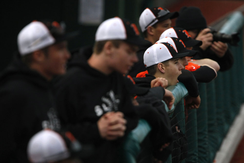 LaPorte players watch the action from the dugout late in a loss to Penn in a high school baseball game on Thursday, March 29, 2012, at Coveleski Stadium in South Bend. (James Brosher/South Bend Tribune)