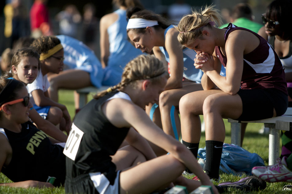Mishawaka's Ashley Spence, right, takes a moment to herself as she waits to take part in an event during the Bremen girl's track and field sectionals on Tuesday, May 15, 2012, at Bremen High School. (James Brosher/South Bend Tribune)