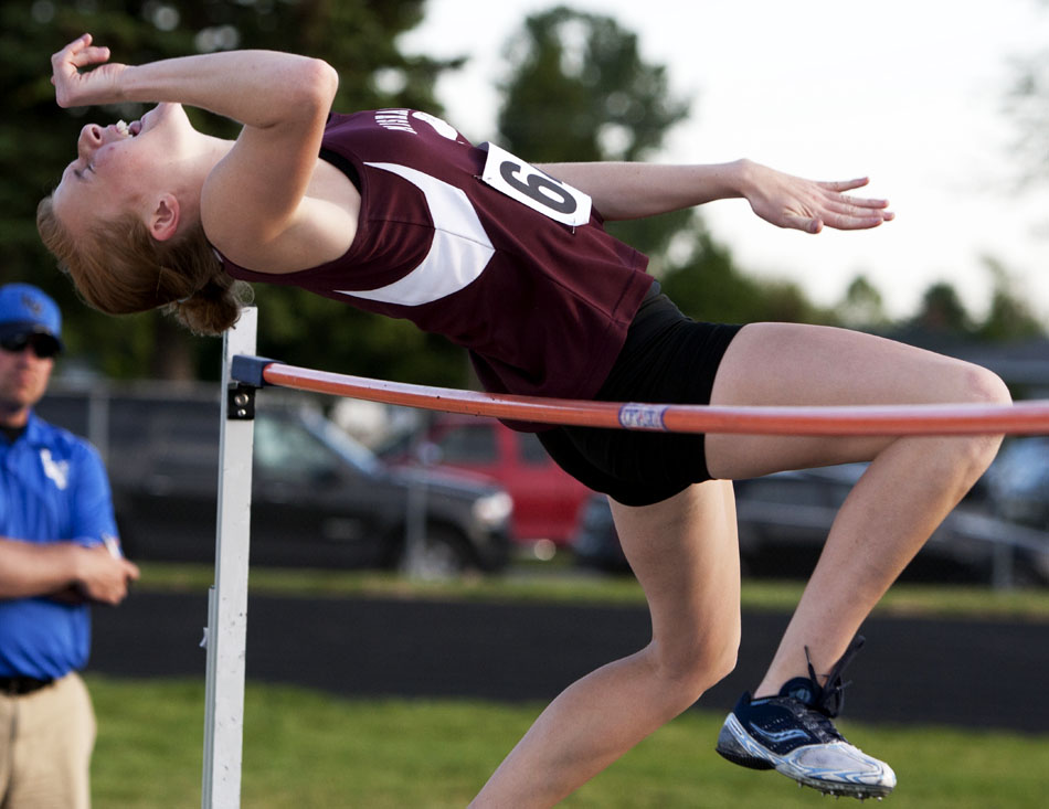Mishawaka's Abby Darr attempts to clear the bar in the high jump during the Bremen girl's track and field sectionals on Tuesday, May 15, 2012, at Bremen High School. (James Brosher/South Bend Tribune)