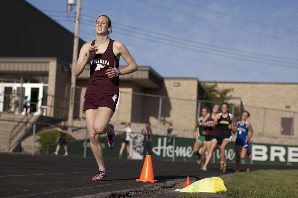 Mishawaka's Jessica Balko takes the lead on the final lap of the 1600 meter run en route to victory during the Bremen girl's track and field sectionals on Tuesday, May 15, 2012, at Bremen High School. (James Brosher/South Bend Tribune)