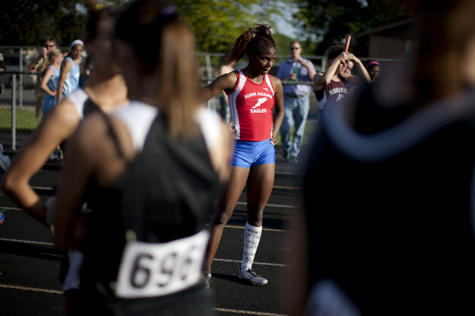 Adams' Aaliyah McKinney waits at the finish line with fellow runners for final results after the 400 meter relay during the Bremen girl's track and field sectionals on Tuesday, May 15, 2012, at Bremen High School. (James Brosher/South Bend Tribune)