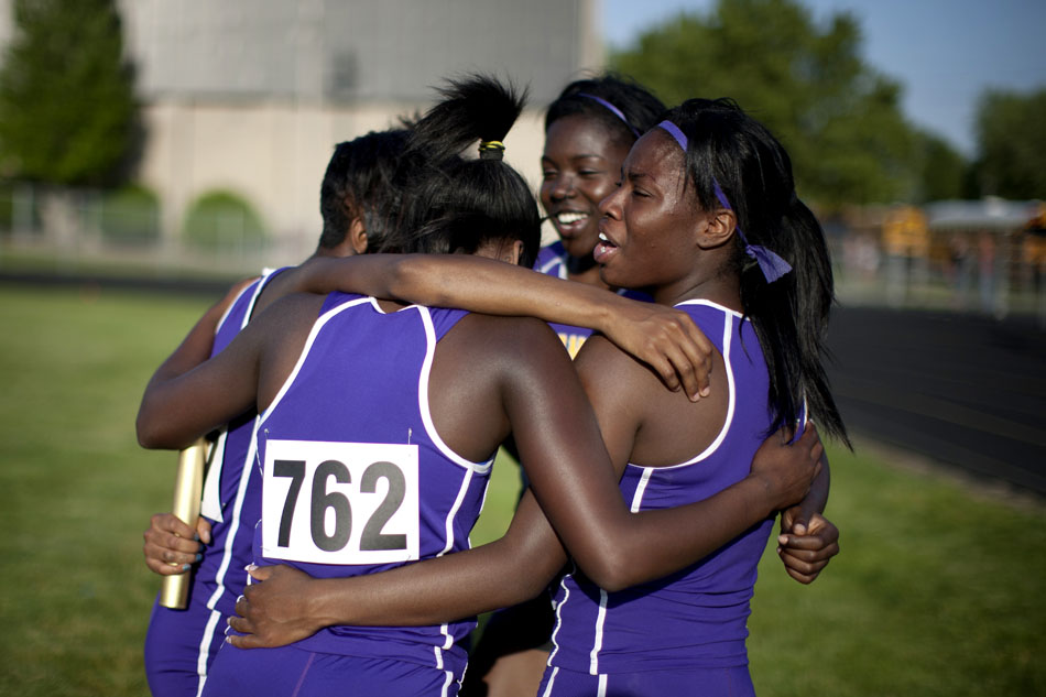 Clay's Ciera Davis, right, celebrates with her teammates after the 400 meter relay during the Bremen girl's track and field sectionals on Tuesday, May 15, 2012, at Bremen High School. (James Brosher/South Bend Tribune)