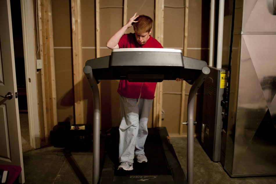 Greg Gaver walks on a treadmill in his family's basement on Wednesday, April 25, 2012, in Granger. Gaver, 21, usually exercises everyday for 30 minutes to help with his Prader-Willi Syndrome, which makes him have an intense craving for food. If not kept in check, the syndrome can lead to extreme binge eating and obesity related conditions such as Type 2 diabetes, according to the Mayo Clinic. (James Brosher/South Bend Tribune)