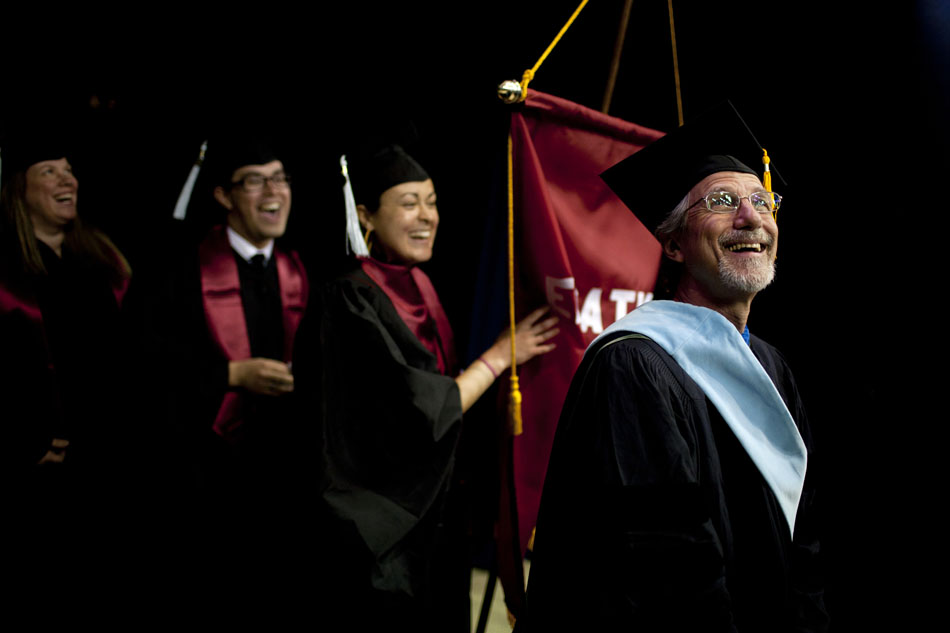 Members of the School of Education delegation share a laugh as they make their way into the arena during Indiana University-South Bend commencement exercises on Tuesday, May 8, 2012, in the Purcell Pavilion at Notre Dame. (James Brosher/South Bend Tribune)