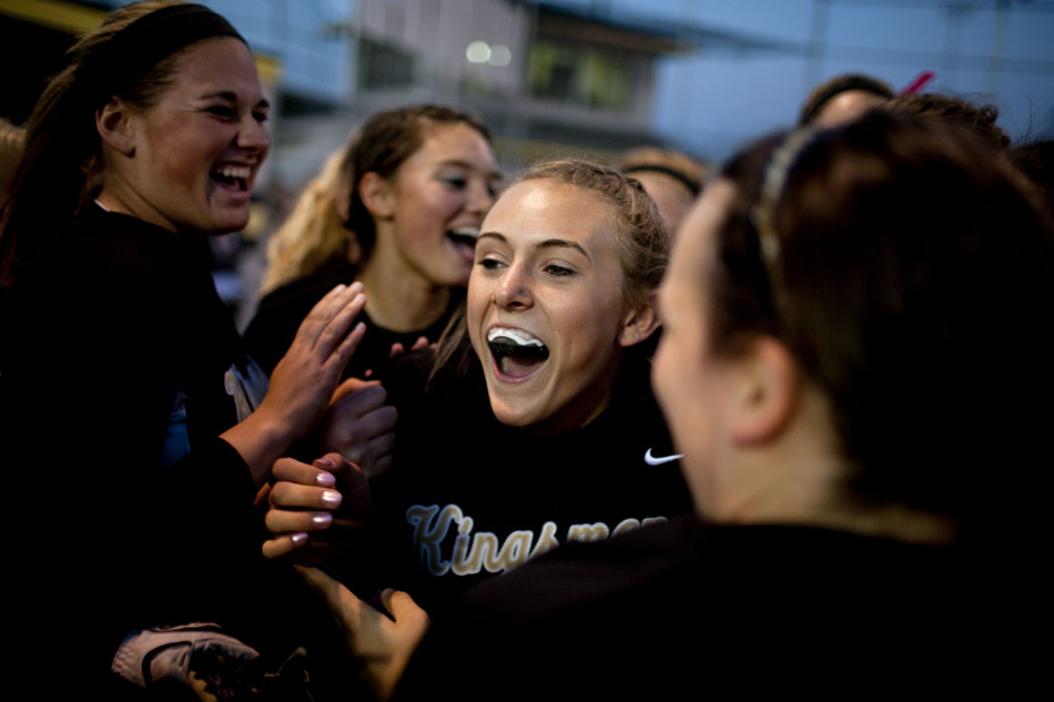 Penn players celebrate with teammate Monica Smith after the final out in a win against Mishawaka in a softball sectional game on Tuesday, May 22, 2012, at Penn High School in Mishawaka. (James Brosher/South Bend Tribune)