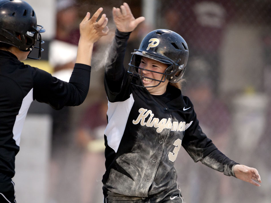 Penn's Alyssa Davis (3) high fives teammate Claryce Gedde after Davis scored a run in the bottom of the sixth inning to give Penn a 6-3 advantage over Mishawaka in a softball sectional game on Tuesday, May 22, 2012, at Penn High School in Mishawaka. Penn would hold off Mishawaka for the win. (James Brosher/South Bend Tribune)
