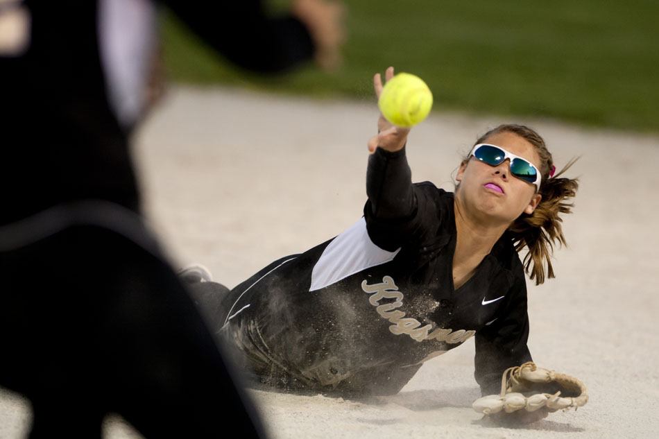 Penn's Alexis Ball flips the ball from the ground to first baseman Sydney Tom for an out during a softball sectional game on Tuesday, May 22, 2012, at Penn High School in Mishawaka. (James Brosher/South Bend Tribune)