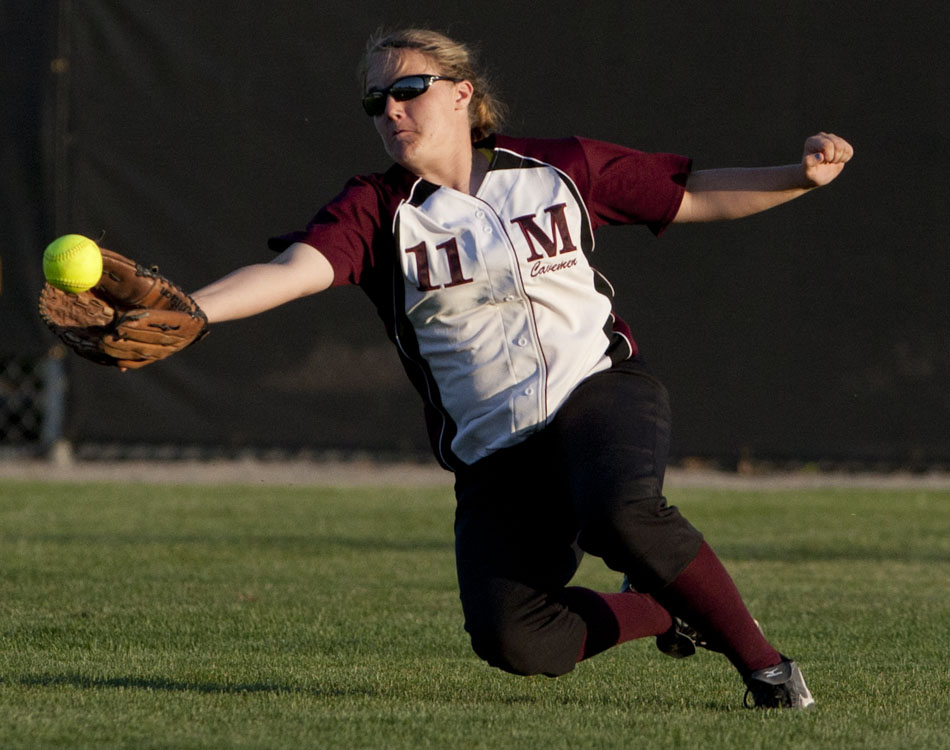 Mishawaka's Jordan Pallo snags a would-be hit in the outfield during a softball sectional game on Tuesday, May 22, 2012, at Penn High School in Mishawaka. (James Brosher/South Bend Tribune)